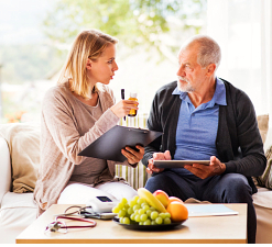 elderly man and caregiver talking